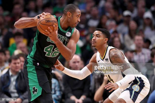 Al Horford of the Boston Celtics is guarded by Gary Harris of the Denver Nuggets at the Pepsi Center on January 29 2018 in Denver Colorado NOTE TO...