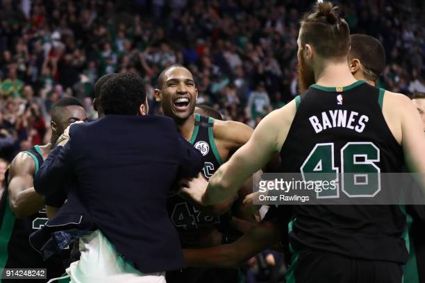 Al Horford of the Boston Celtics is mobbed by the rest of the Boston Celtics team after scoring the game winning shot at the end of the fourth...