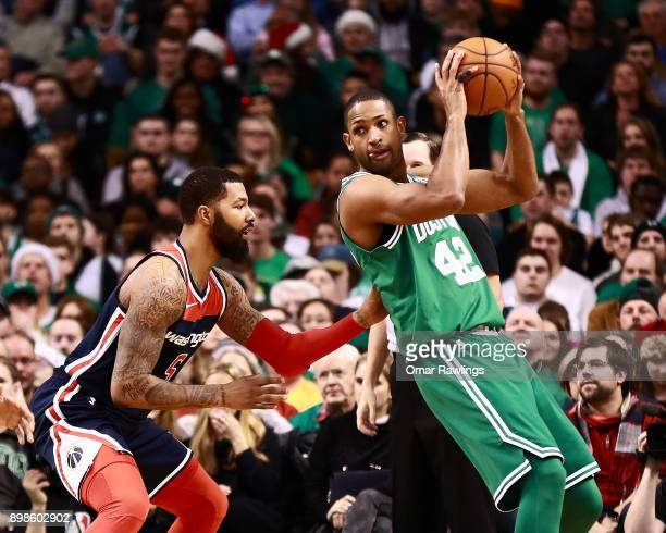 Al Horford of the Boston Celtics posts up against Markieff Morris of the Washington Wizards during the second quarter of the game at TD Garden on...