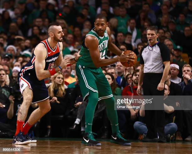 Al Horford of the Boston Celtics posts up Marcin Gortat of the Washington Wizards during the game at TD Garden on December 25 2017 in Boston...