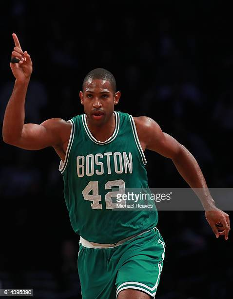 Al Horford of the Boston Celtics reacts after a basket in the first half of the preseason game against the Brooklyn Nets at Barclays Center on...
