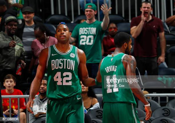 Al Horford of the Boston Celtics reacts after blocking a shot against the Atlanta Hawks with Kyrie Irving at Philips Arena on November 6 2017 in...