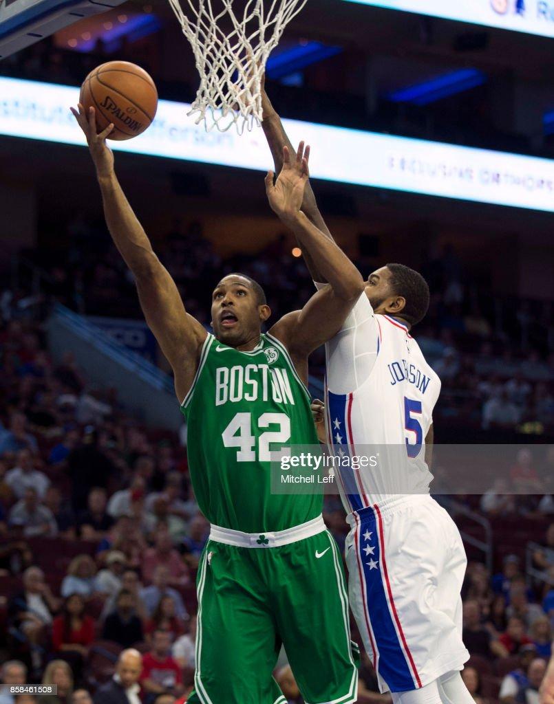 Al Horford #42 of the Boston Celtics shoots the ball against Amir Johnson #5 of the Philadelphia 76ers in the the preseason game at the Wells Fargo Center on October 6, 2017 in Philadelphia, Pennsylvania.