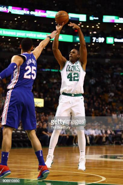 Al Horford of the Boston Celtics shoots the ball during the first half against Ben Simmons of the Philadelphia 76ers at TD Garden on January 18 2018...