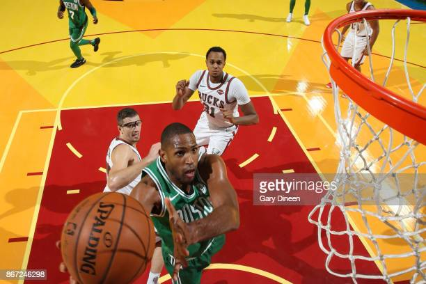 Al Horford of the Boston Celtics shoots the ball during the game against the Milwaukee Bucks on October 26 2017 at the UWMilwaukee Panther Arena in...