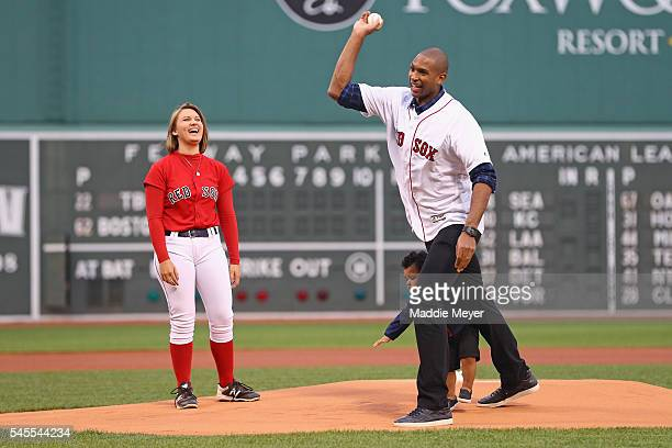 Al Horford of the Boston Celtics throws out the first pitch with his son Ean before the game between the Boston Red Sox and the Tampa Bay Rays at...