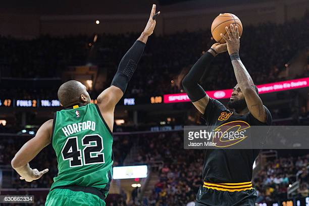 Al Horford of the Boston Celtics tries to block LeBron James of the Cleveland Cavaliers during the second half at Quicken Loans Arena on December 29...