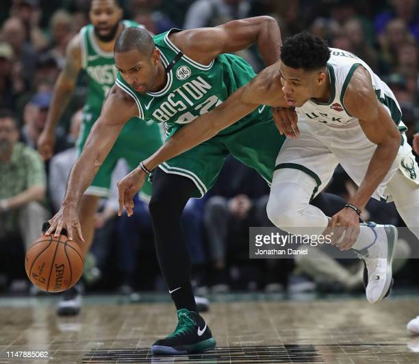 Al Horford of the Boston Celticsand Giannis Antetokounmpo of the Milwaukee Bucks battle for a loose ball at Fiserv Forum on May 08 2019 in Milwaukee...
