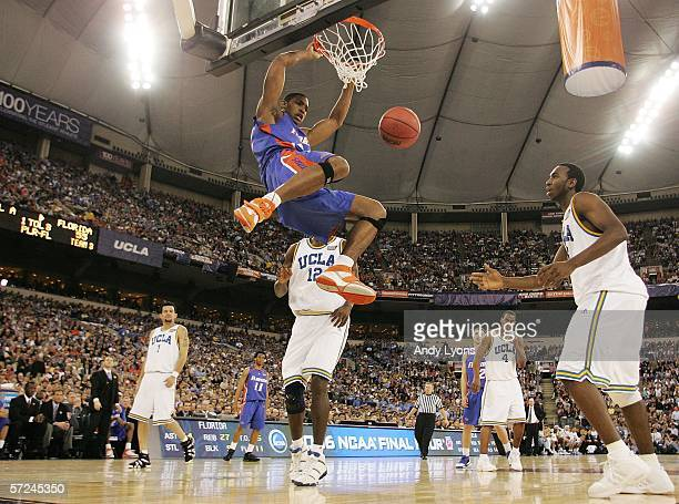 Al Horford of the Florida Gators slam dunks the ball against the UCLA Bruins defense in the second half during the National Championship game of the...