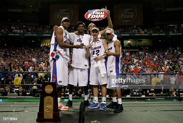 Al Horford, Taurean Green, Joakim Noah, Lee Humphrey and Corey Brewer of the Florida Gators celerate after defeating the Ohio State Buckeyes during...