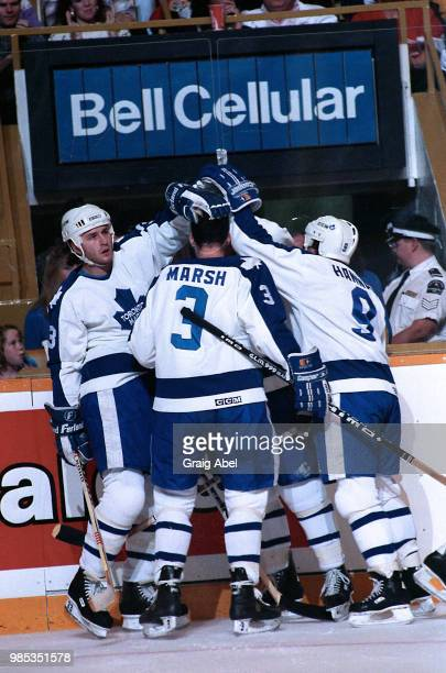 Al Iafrate Brad Marsh and Dave Hannan of the Toronto Maple Leafs skate against the Detroit Red Wings during NHL game action October 28 at Maple Leaf...