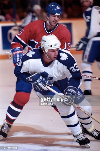Al Iafrate of the Toronto Maple Leafs skates against Bobby Smith of the Montreal Canadiens during NHL game action on January 27 1990 at Maple Leaf...