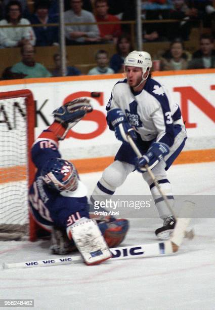 Al Iafrate of the Toronto Maple Leafs skates against Kelly Hrudey of the New York Islanders during NHL game action On December 26 1988 at Maple Leaf...