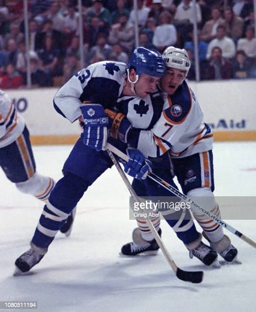 Al Iafrate of the Toronto Maple Leafs skates against Mike Donnelly of the Buffalo Sabres during NHL game action on March 16 1990 at Buffalo Memorial...
