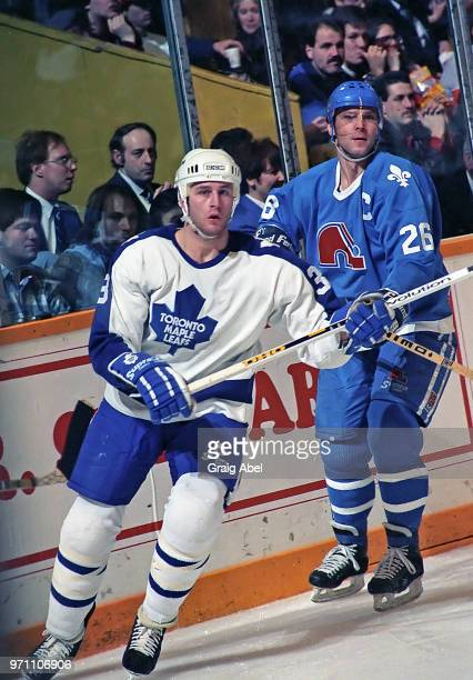 Al Iafrate of the Toronto Maple Leafs skates against Peter Stastny of the Quebec Nordique during NHL game action on February 28 1990 at Maple Leaf...