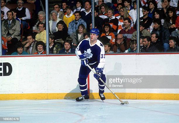 Al Iafrate of the Toronto Maple Leafs skates with the puck during an NHL game against the Philadelphia Flyers on February 4 1988 at the Spectrum in...