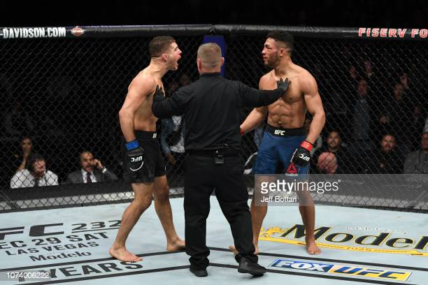 Al Iaquinta and Kevin Lee react after the conclusion of their lightweight bout during the UFC Fight Night event at Fiserv Forum on December 15 2018...
