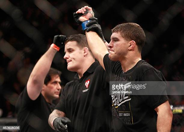 Al Iaquinta has his hand raised after defeating Joe Lauzon in a lightweight bout during UFC 183 at the MGM Grand Garden Arena on January 31 2015 in...