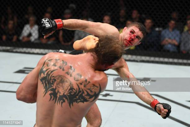 Al Iaquinta kicks Donald Cerrone in their lightweight bout during the UFC Fight Night event at Canadian Tire Centre on May 4 2019 in Ottawa Ontario...