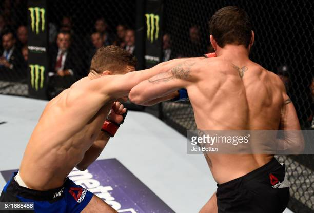 Al Iaquinta knocks out Diego Sanchez with a right in their lightweight bout during the UFC Fight Night event at Bridgestone Arena on April 22 2017 in...