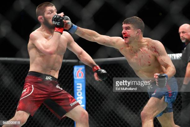 Al Iaquinta lands a right hand to the head of Khabib Nurmagomedov during their UFC lightweight championship bout at UFC 223 at Barclays Center on...