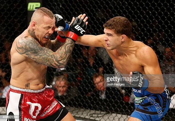 Al Iaquinta of the United States punches Ross Pearson of England in their lightweight bout during the UFC Fight Night event inside Allphones Arena on...