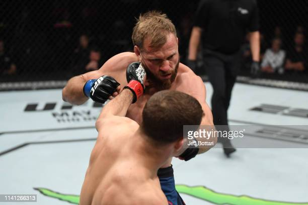 Al Iaquinta punches Donald Cerrone in their lightweight bout during the UFC Fight Night event at Canadian Tire Centre on May 4 2019 in Ottawa Ontario...