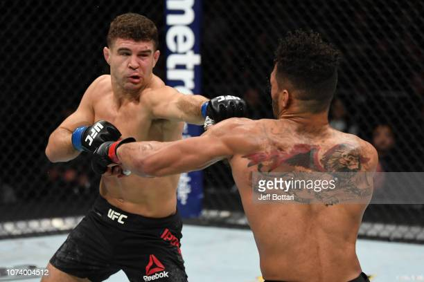 Al Iaquinta punches Kevin Lee in their lightweight bout during the UFC Fight Night event at Fiserv Forum on December 15 2018 in Milwaukee Wisconsin