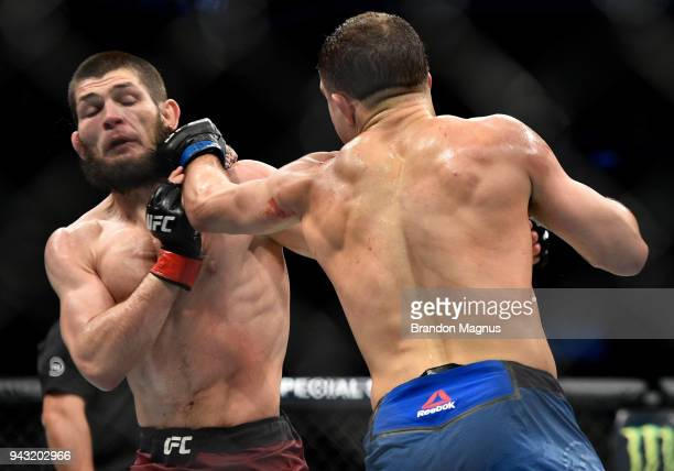 Al Iaquinta punches Khabib Nurmagomedov of Russia in their lightweight title bout during the UFC 223 event inside Barclays Center on April 7 2018 in...