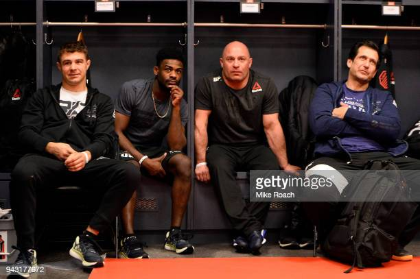 Al Iaquinta relaxes with his team in his locker room prior to his bout against Khabib Nurmagomedov of Russia during the UFC 223 event inside Barclays...
