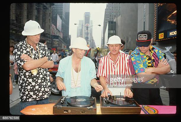 Al Jardine and Carl Wilson spin for the camera at a Beach Boys performance at Times Square Brian Wilson and Mike Love watch as the two perform