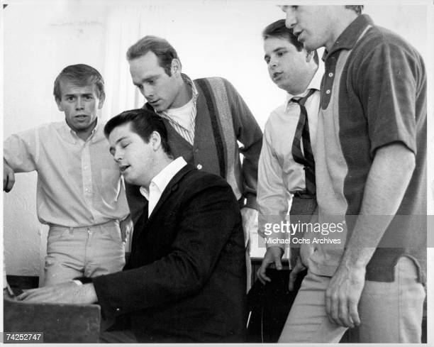 Al Jardine Brian Wilson Mike Love Carl Wilson and Dennis Wilson of the rock and roll band The Beach Boys sing around a piano
