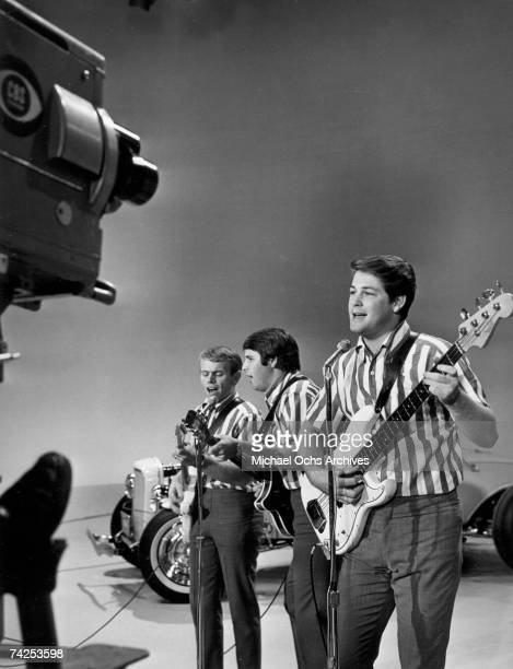 Al Jardine Carl Wilson and Brian Wilson of the rock and roll band The Beach Boys perform the song I Get Around onstage on The Ed Sullivan Show in...