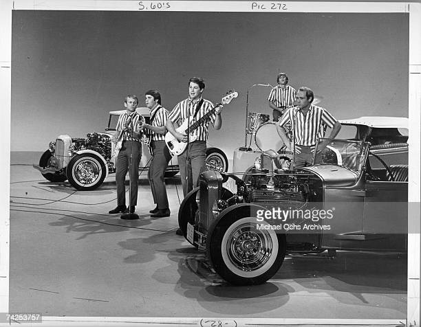 """Al Jardine, Carl Wilson, Brian Wilson, Dennis Wilson and Mike Love of the rock and roll band """"The Beach Boys"""" perform the song """"I Get Around"""" onstage..."""