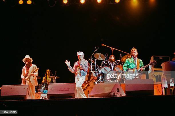 Al Jardine Mike Love Dennis Wilson and Carl Wilson of The Beach Boys with session musician Bobby Figueroa on percussion perform on stage at Knebworth...