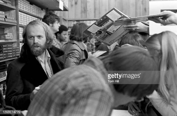 Al Jardine prepares to sign autographs at a Beach Boys instore appearance at Peaches Records on January 12 1977 in Atlanta Georgia n