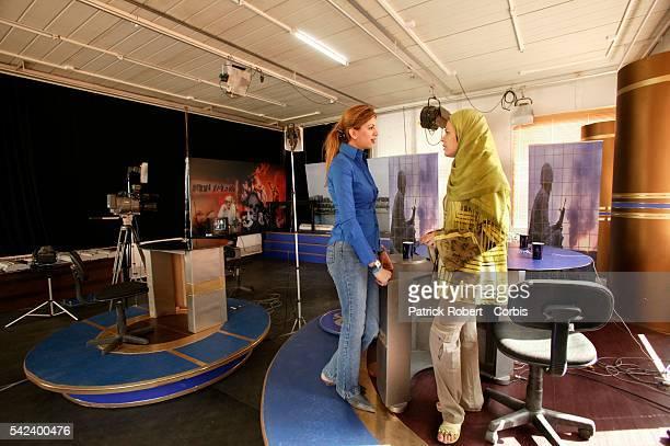 Al Jazeera former Iraqi TV anchorwoman Athiaf chats to Al Jazeera's Public Relation's officer Safana in the news studio