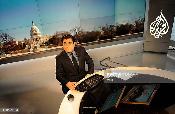 Al Jazeera network anchor Shihab Rattansi prepares to start the afternoon news program at the Al Jazeera English language channel studio in...