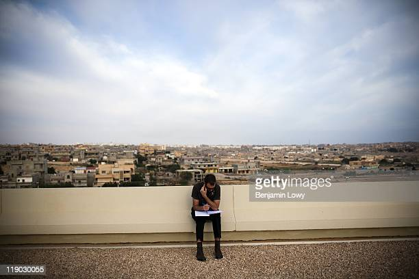 Al Jazeera producer Guy Henshilwood makes a phone call from the roof of a hotel on March 13 2011 in Tobruk Libya