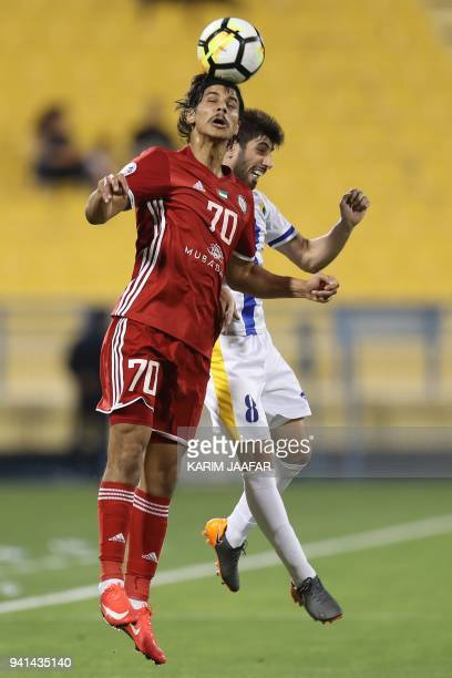 Al Jazira's Ahmed Husain Al Hashmi vies with Al Gharafa's Yousuf Muftar during the AFC Champions League match between Qatar's alGharafa and UAE's...