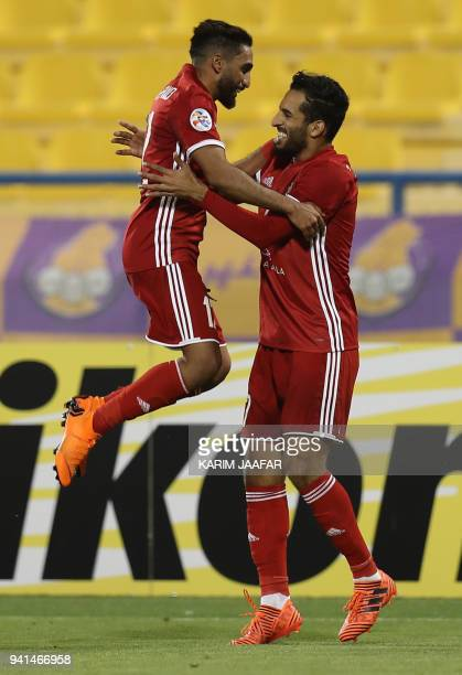 Al Jazira's Ali Ahmed Mabkhout and Salim Rashid Obaid celebrate after scoring a goal during the AFC Champions League match between Qatar's alGharafa...