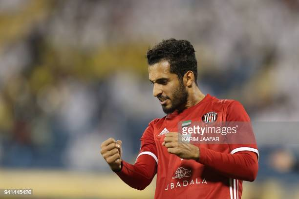 Al Jazira's Ali Ahmed Mabkhout celebrates after scoring a goal during the AFC Champions League match between Qatar's alGharafa and UAE's AlJazira at...