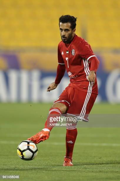 Al Jazira's Ali Ahmed Mabkhout passes the ball during the AFC Champions League match between Qatar's alGharafa and UAE's AlJazira at the Thani Bin...