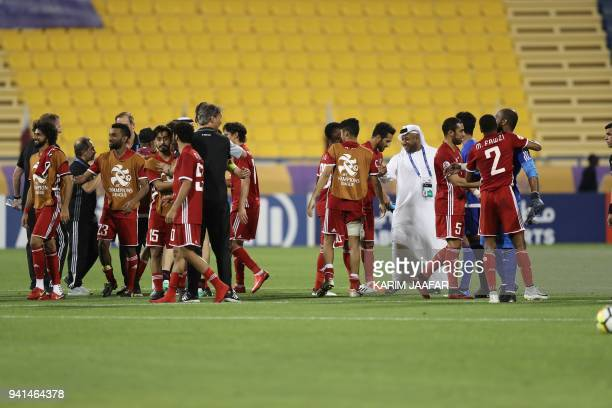Al Jazira's players celebrate after the AFC Champions League match between Qatar's alGharafa and UAE's AlJazira at the Thani Bin Jassim Stadium in...