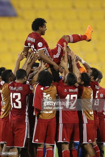 Al Jazira's Romarinho is carried triumphantly after the AFC Champions League match between Qatar's alGharafa and UAE's AlJazira at the Thani Bin...