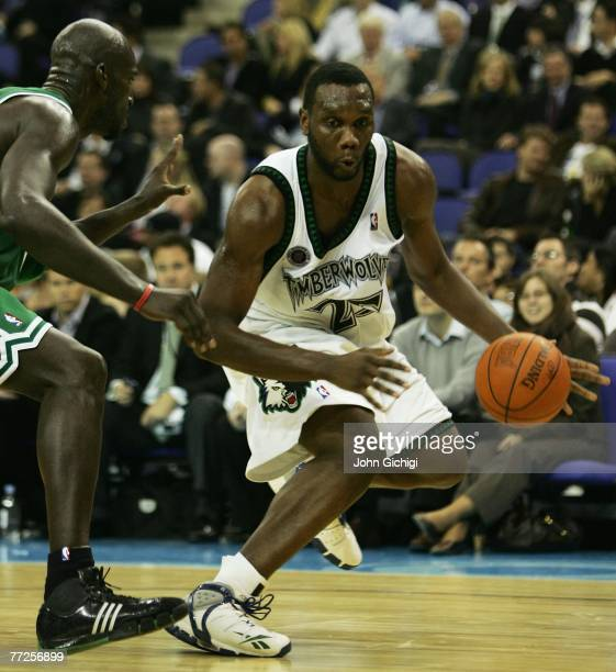 Al Jefferson of Minnesota is challenged by Kevin Garnett of Boston during NBA Europe Live 2007 Tour match between the Boston Celtics and the...