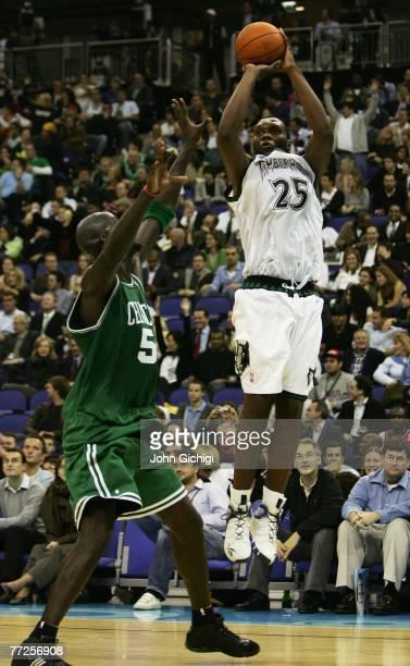 Al Jefferson of Minnesota shoots past Kevin Garnett of Boston during NBA Europe Live 2007 Tour match between the Boston Celtics and the Minnesota...