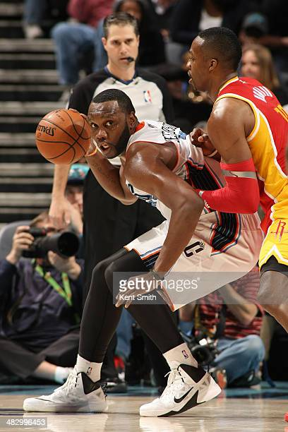 Al Jefferson of the Charlotte Bobcats handles the ball against the Houston Rockets during the game at the Time Warner Cable Arena on March 24 2014 in...
