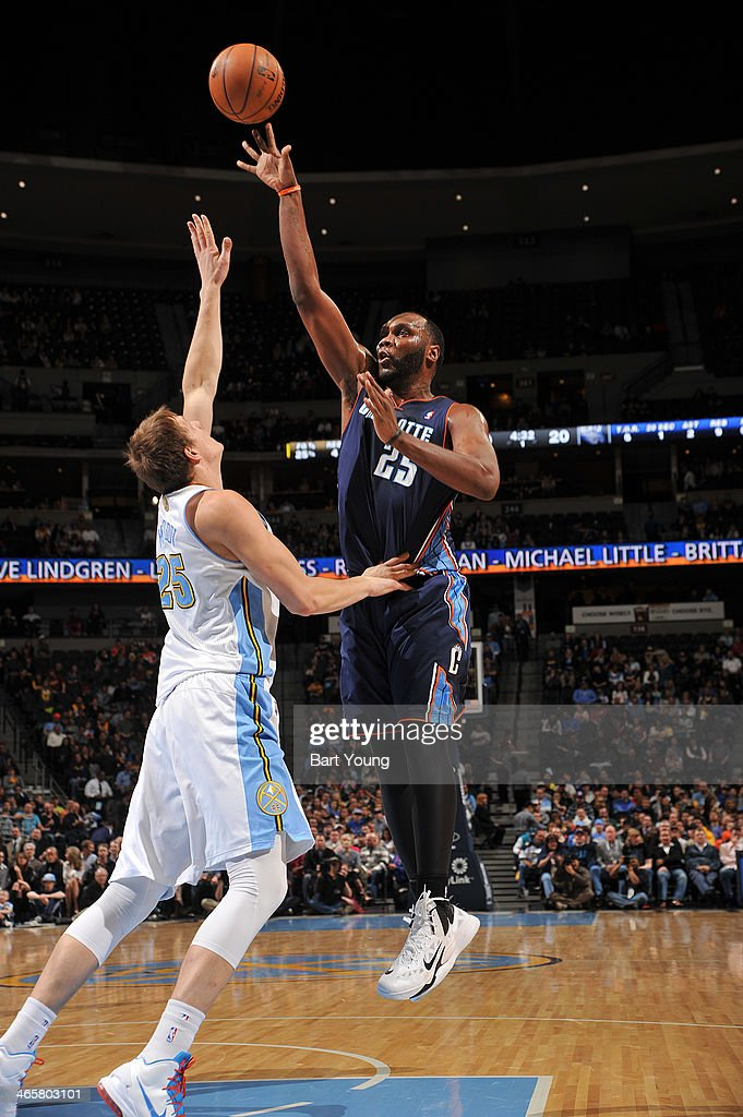 Al Jefferson #25 of the Charlotte Bobcats taking a shot during a game against the Denver Nuggets on January 29, 2014 at the Pepsi Center in Denver, Colorado.
