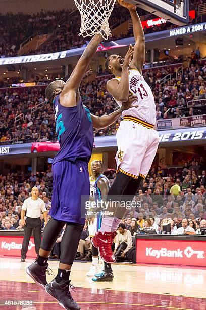 Al Jefferson of the Charlotte Hornets guards Tristan Thompson of the Cleveland Cavaliers during the second half at Quicken Loans Arena on December 15...